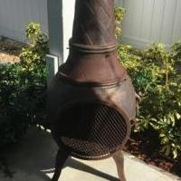 Cast Iron Ouutdoor Firebox with Tall  chimney for sale in Jensen Beach FL by Garage Sale Showcase member Meliss, posted 10/20/2018
