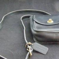 Coach purse in black leather for sale in Antrim County MI by Garage Sale Showcase member 3Musketeers, posted 02/15/2019