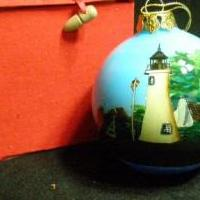 Alessandra Glass inside painted Presque Isle Lighthouse Ornament for sale in Antrim County MI by Garage Sale Showcase member 3Musketeers, posted 02/15/2019