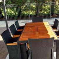 Teak and resin outdoor table andeight chairs for sale in Tinton Falls NJ by Garage Sale Showcase member Cameron0426, posted 10/13/2018