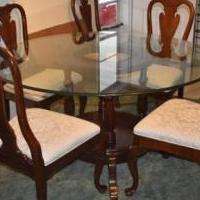 Glass Round Table W/ Cherry Wood Base for sale in New Port Richey FL by Garage Sale Showcase member Diana57, posted 04/07/2019