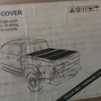 Tonneau Cover tri-fold black for sale in Tonawanda NY by Garage Sale Showcase member Magoo1964, posted 03/24/2019