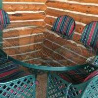 Wrought iron outdoor dining table and 6 chairs for sale in Balsam Lake WI by Garage Sale Showcase member SallyRedding, posted 05/04/2019