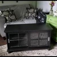 Sliding glass door black cabinet for sale in Greenfield IN by Garage Sale Showcase member KEN SMOAK, posted 06/08/2019