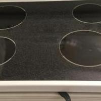 GE electric stove, 4 burners, white for sale in Jupiter FL by Garage Sale Showcase member ch0084, posted 02/02/2020