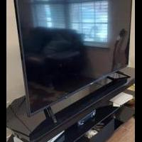 "52"" Flat T.V. with stand for sale in Princeton TX by Garage Sale Showcase member erezgi, posted 02/27/2021"