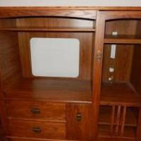 Entertainment Center - Medium Oak for sale in North Liberty IA by Garage Sale Showcase Member Jsknight007