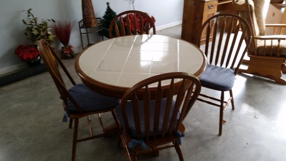 "42"" Round tile top pedistal table + 4 chairs"