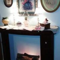 Fireplace Mantel with lit log unit for sale in Norwalk OH by Garage Sale Showcase member victorian, posted 07/25/2018